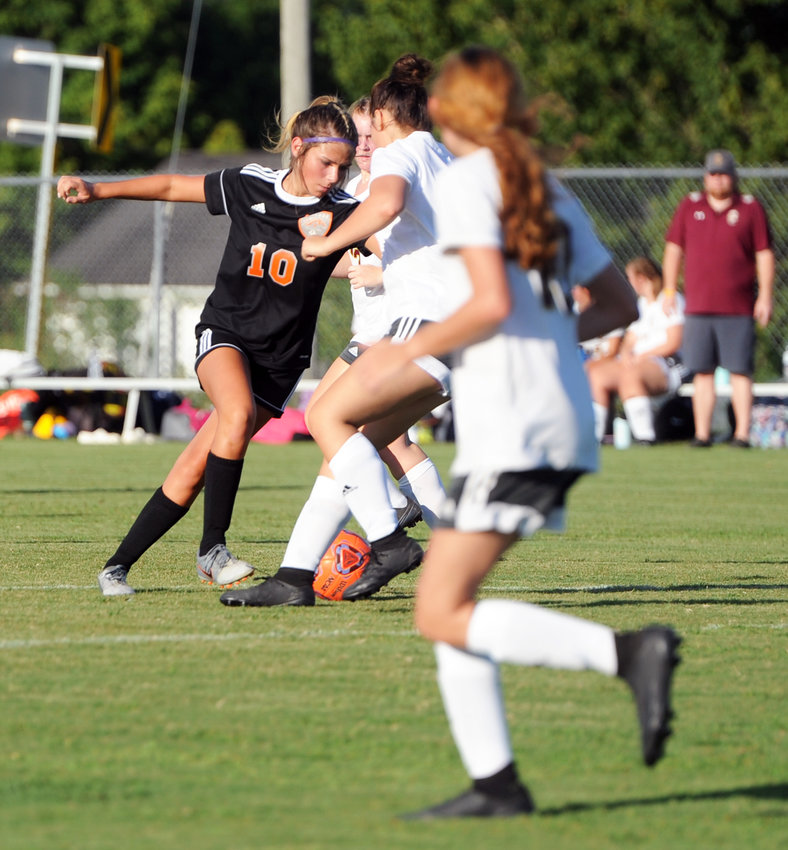 Morgan Housch slices her way through the Cannon County defense and fires a strike to the back of the net in the 26th minute.