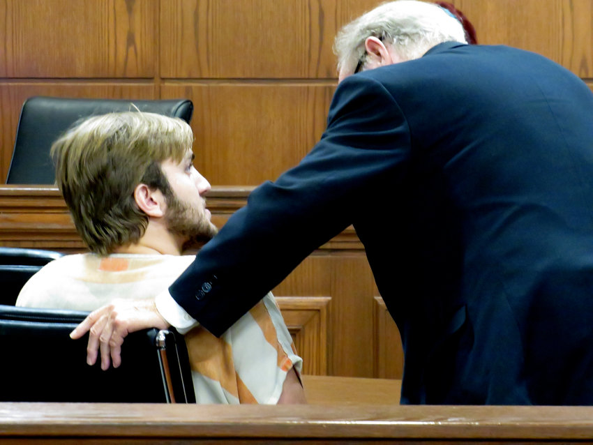 Samuel Earl Rich confers with court-appointed attorney Robert Marlow during a General Sessions Court appearance. The appearance was to appoint an attorney  and set a date for a preliminary hearing.