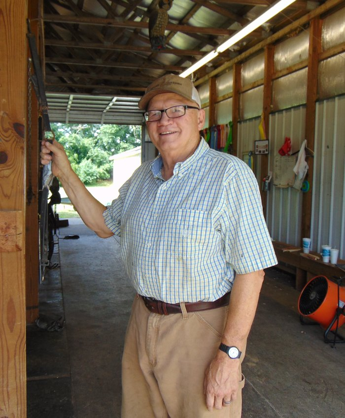Dale Watts at his barn, Pioneer Stables, in Shelbyville.