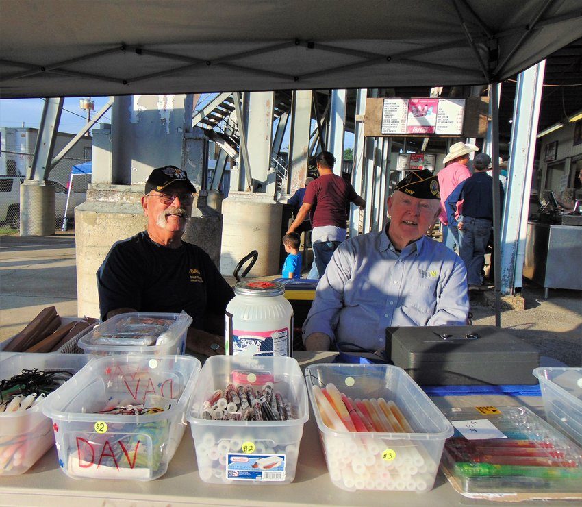 Andy Smith, left, served in the U.S Air Force from 1970 to 1974. Jim Short served in the U.S. Army from 1975 to 1995. Now, as part of the Chapter 43 Disabled American Veterans (DAV), they sell glow sticks at the Tennessee Walking Horse National   Celebration.