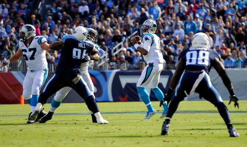 Cam Newton stands tall in the pocket and delivers a pass to former tight end Greg Olsen against the Titans in 2015.