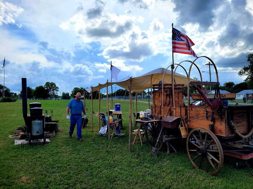 """Jones Chuck Wagon, owned by Jeremy and Brandy Jones, served some authentic country food Tuesday night. Cooking   for as many as 100 people, the trick to cooking over a fire and wood stove is """"good timing and patience."""""""