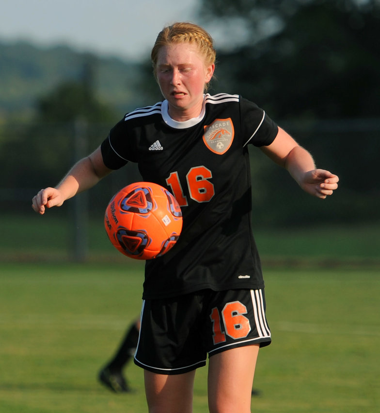 Cascade senior Rachel Phillips settles a loose ball in the first half against Forrest on Monday night. She scored the game's second goal in the 29th minute.