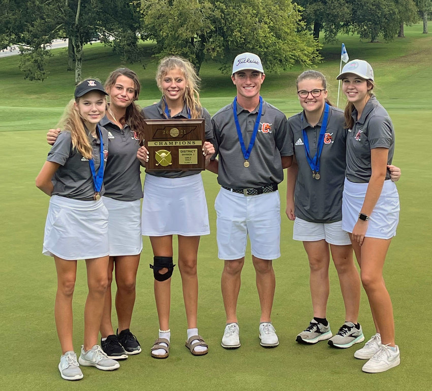 The Lady Champions and Evan Woosley-Reed pose after the final scores are tallied during Monday's district match at Henry Horton.