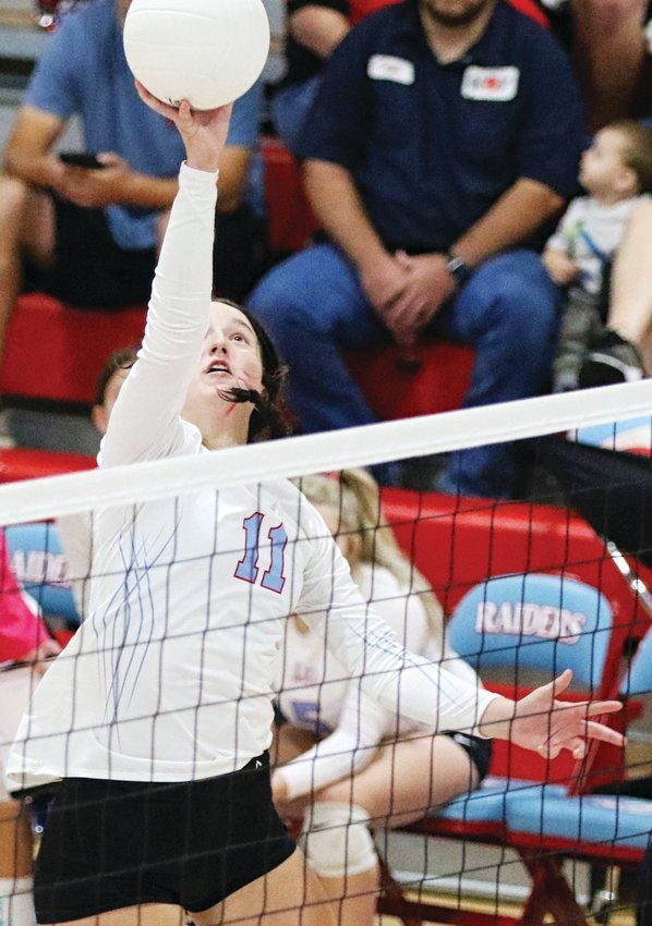 Lumberton's Ocean Ling (11) pushes the ball over the net in the Lady Raiders' District 22-4A win at home over Vidor on Oct. 9.