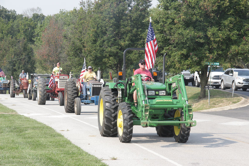 TRACTOR CRUISE — Tractors begin their cruise through southern Warren County on a mission to collect food and money for area food pantries during the Journey For Charity Tractor Cruise on Sept. 12.
