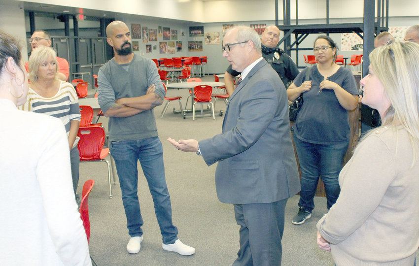 Warren County R-III Superintendent Dr. Gregg Klinginsmith speaks with community members after a Sept. 9 school board meeting.