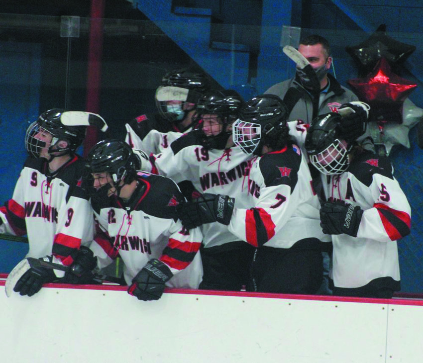 CELEBRATION: Members of the Warwick co-op celebrate after a goal against Cranston. (Photos by Alex Sponseller)