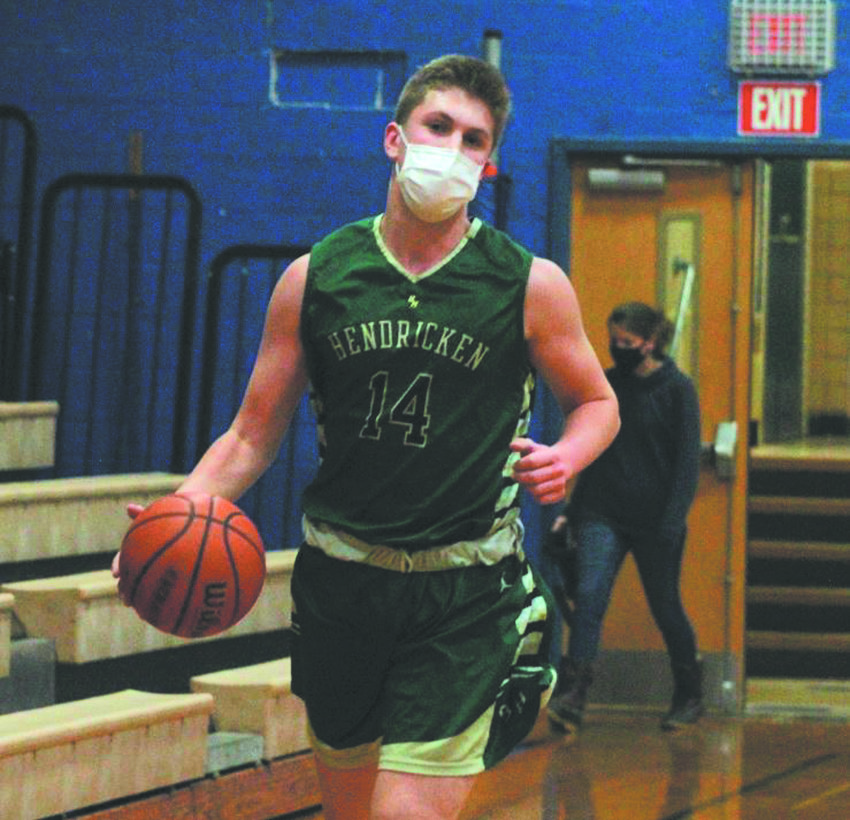 GETTING THE WIN: Bishop Hendricken's David Lynch takes the ball up the court. (