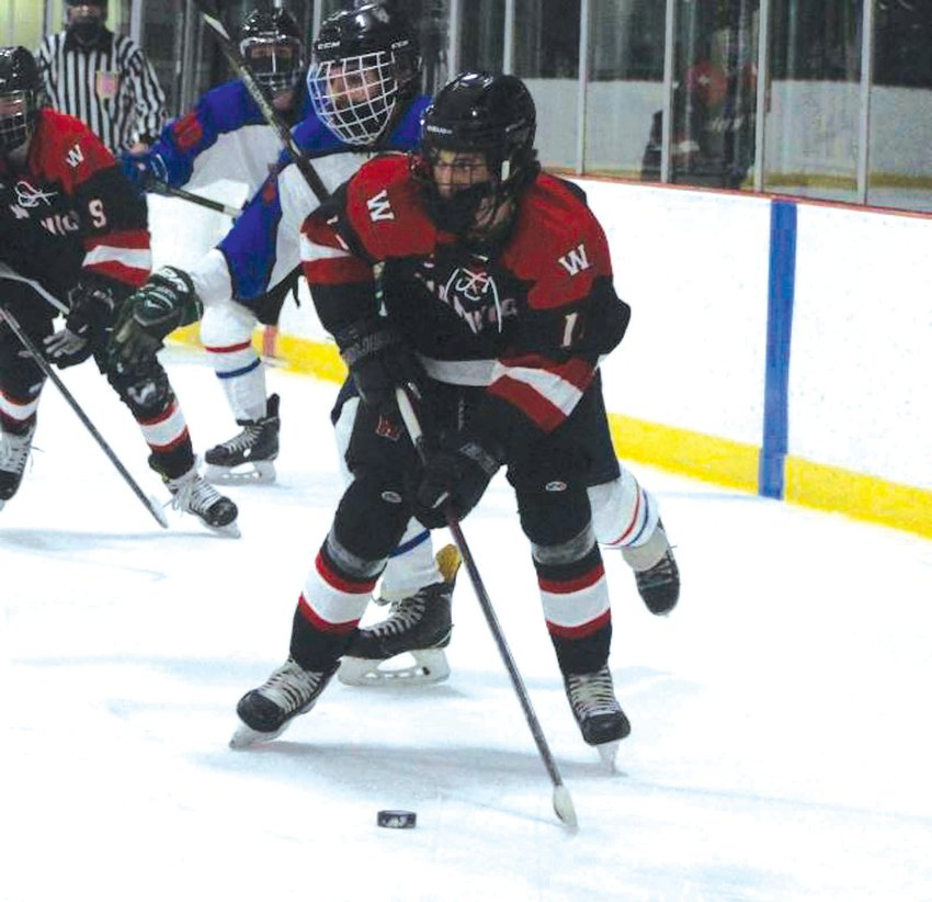 UP THE ICE: Warwick's Jacob Rianna takes the puck  up the ice in the quarters.