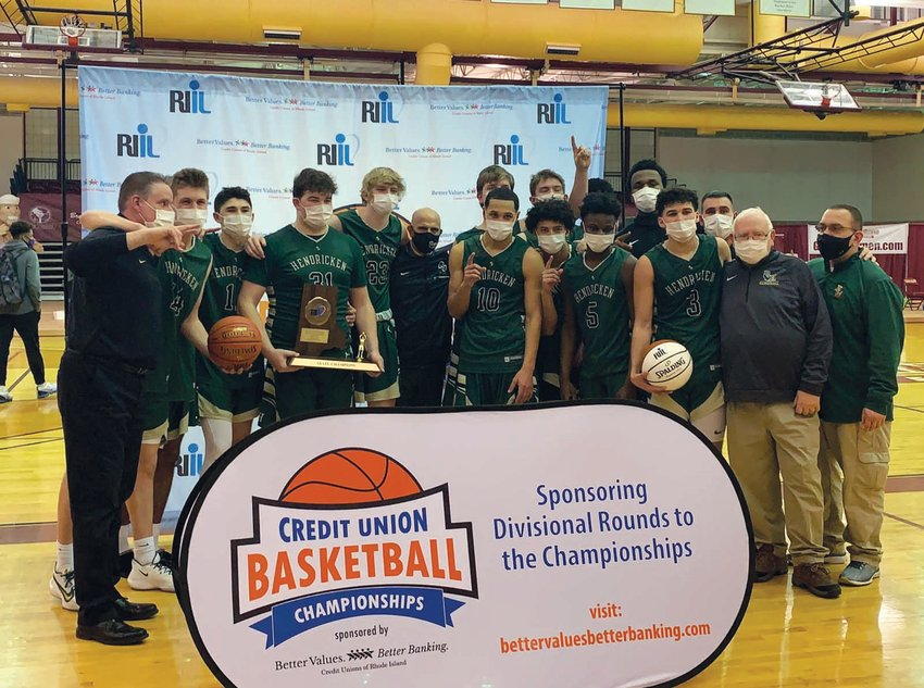 BACK TO BACK: The Bishop Hendricken basketball team after winning the Division I title.