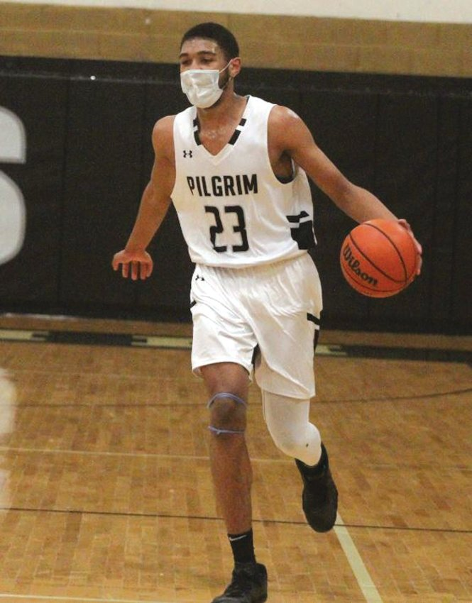 ALL-STATE: Pilgrim forward Tyriek Weeks during a game this past winter season. Weeks was named First-Team, All-State as well as All-Division for the Pats.