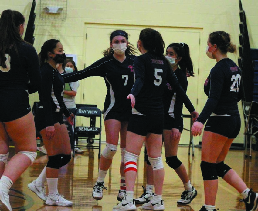COMEBACK KIDS: Members of the Toll Gate volleyball team celebrate after scoring. (Photos by Alex Sponseller)