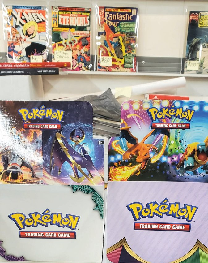 SURGE IN DEMAND: Pokémon card display boxes sit empty on the front counter of The Time Capsule on Pontiac Avenue. Owner Robert Yeremian explained that the demand for these cards, along with various other collectibles, has increased exponentially since the pandemic began. Recently surging sales, coupled with this unexpectedly high demand, seem to be the root of his difficulties in replenishing stock.