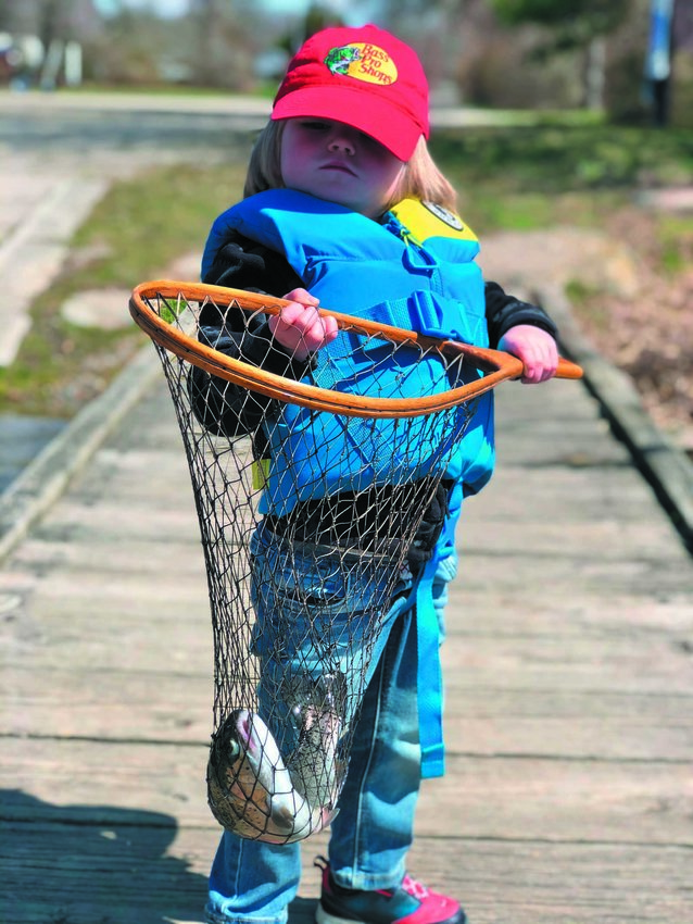 FIRST TROUT: Benjamin Desmond (three years old) with his first trout caught opening day, April 7. He was fishing with his grandfather Greg Vespe.