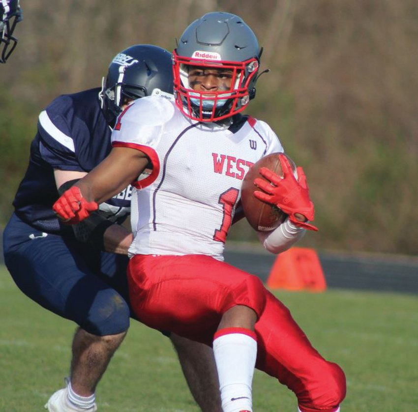 BETWEEN THE TACKLES: Cranston West's Marcus Chung picks up some yards. (Photos by Alex Sponseller)