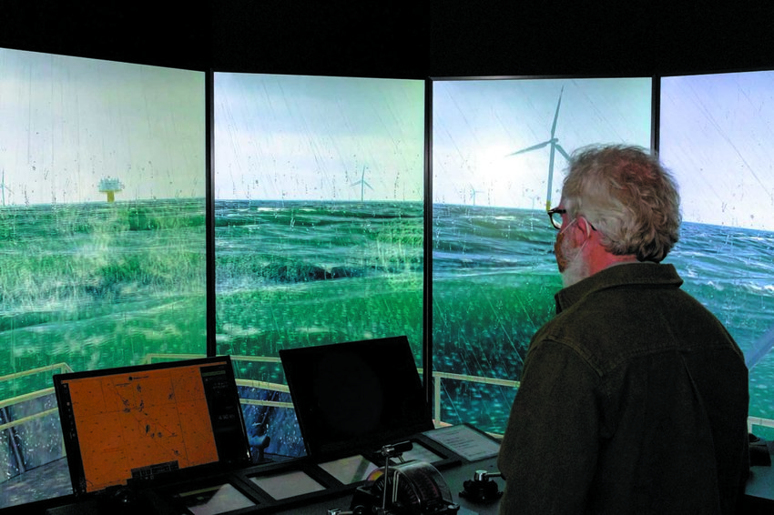 PILOTING IN WIND FARM: Todd Corayer, fishing guide and fishing writer, tries his hand at piloting through a wind farm in high seas, wind and rain at the Revolution wind farm simulator. (Submitted photos) Capt. Patrick Cassidy