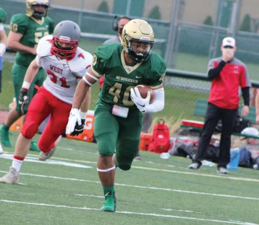UNDEFEATED: Hendricken's Teighan Jeremy carries the ball against Cranston West. (Photos by Ryan D. Murray)