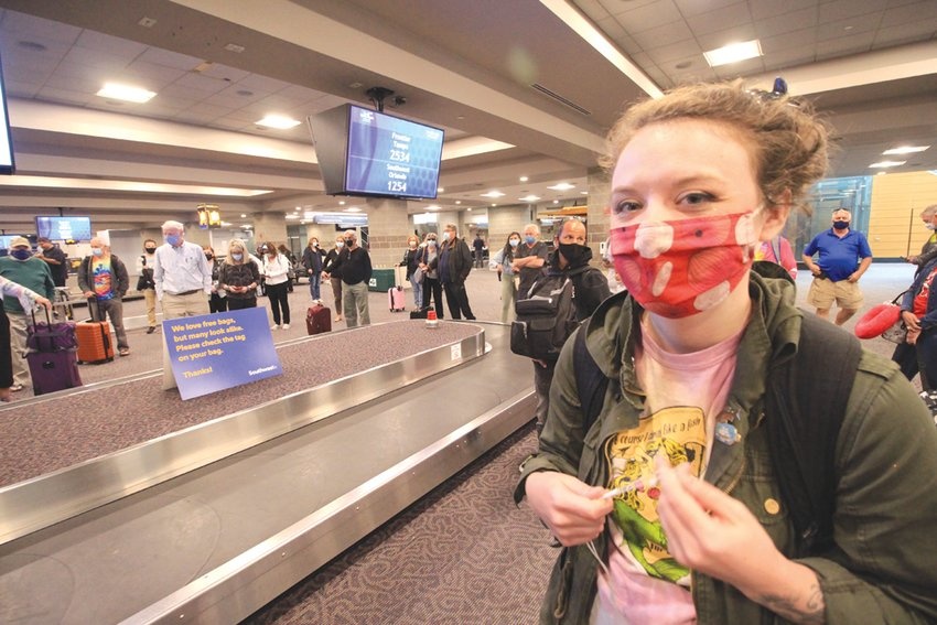 COULDN'T RESIST THE FARES: Graphics arts designer Megan Comtois, who returned Friday from a trip to visit relatives in Florida, said she couldn't pass up the low cost fares to make the trip.