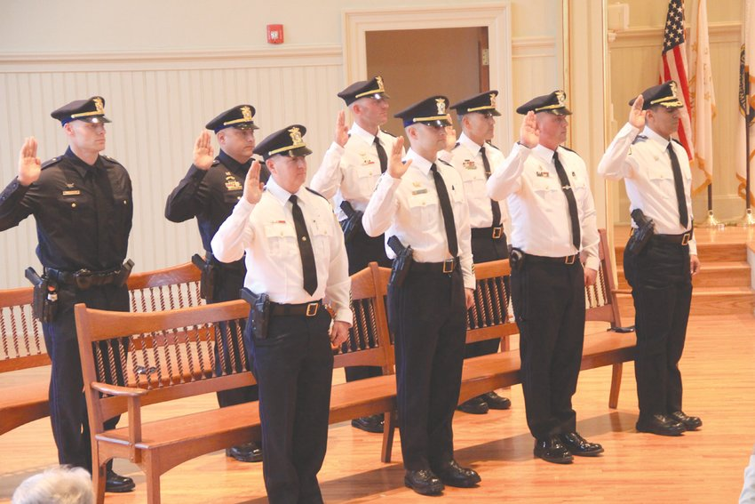 OATH OF OFFICE: Those police officers recently promoted recite the oath of office that was administered by Mayor  Frank Picozzi. They are from left front row: Major Michael G. Lima, Captain Robert T. Hart, Captain Daniel F. DiMaio  and Lieutenant Joseph E. Mee; second row:Lieutenant Thomas A. DiGregorio, Lieutenant John M. Curley IV, Sergeant Matthew S. Moretti, and Sergeant Walter C. Larson.