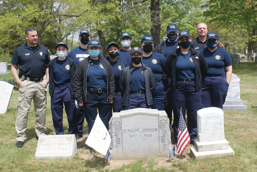 PAYING TRIBUTE: Members of the Cranston Police Explorers visited the graves of four fallen Cranston Police officers this past Saturday to pay tribute and place memorial flags. Also pictured are Inspector Thomas Okolowitcz, and Detective Robert Santagata.