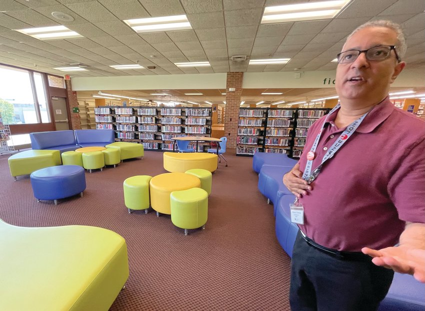 OPEN DOORS: Cranston Public Library Director Ed Garcia  provides a tour of the Central Library's new teen area  on Monday.