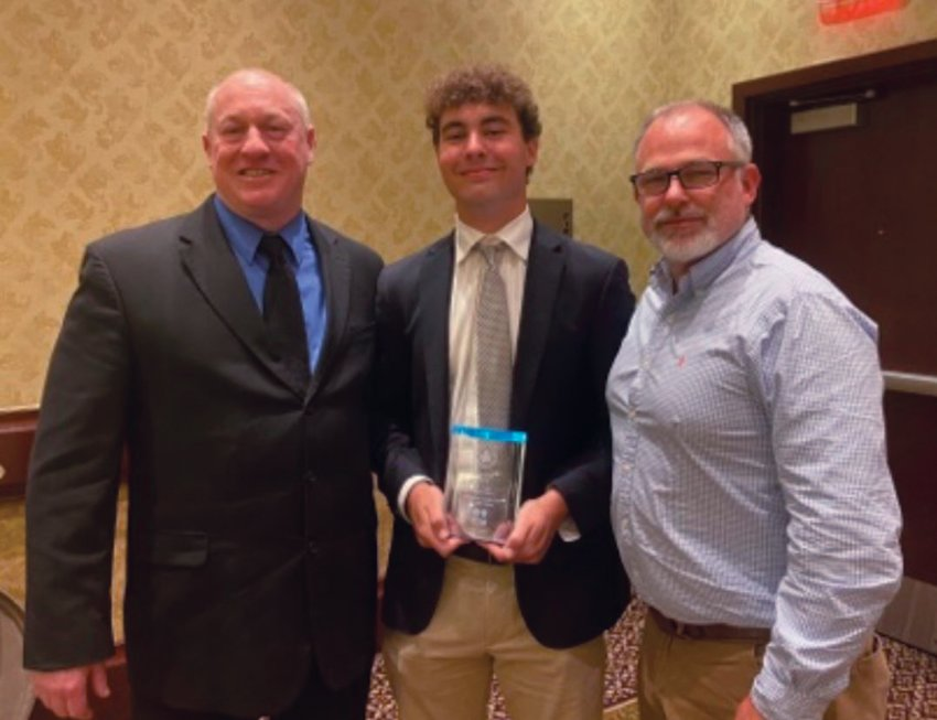 AWARD WINNER: Pilgrim's Kenny Rix (center) after receiving the award for the Rhode Island Interscholastic League's male student-athlete of the year. Pictured alongside are Pilgrim principal Gerry Habershaw (left) and Pilgrim athletic director Scott Bayha.