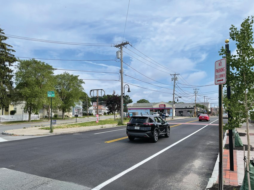 ONE WAY? Vehicle travel north on Rolfe Square Tuesday morning. The City Council's Ordinance Committee last week continued consideration of a proposal that would make the street one way.