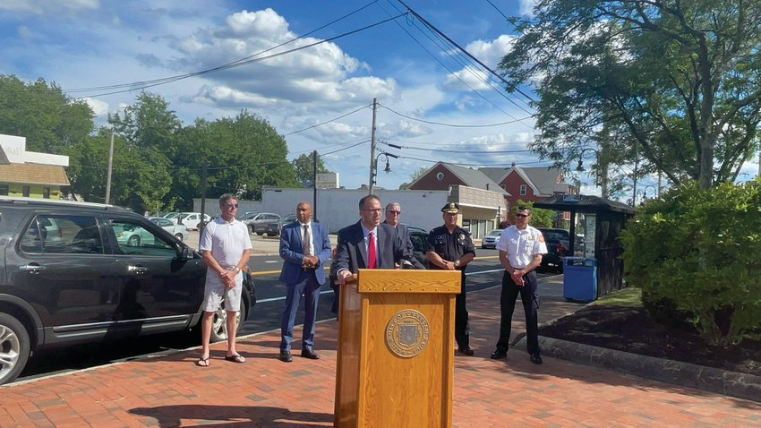 ON THE SQUARE: Ward 6 Councilman Matt Reilly speaks during a press conference on Rolfe Square last week. Also pictured are City Solicitor Chris Millea, Economic Development Director Franklin Paulino, Mayor Ken Hopkins, Police Maj. Robert Quirk and Fire Chief James Warren.