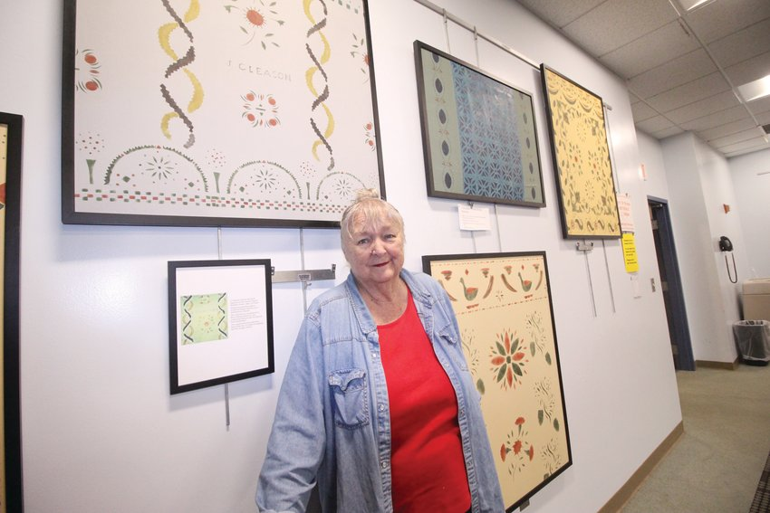 """ARTIST AND HISTORIAN: Ann Eckert Brown has been working on preserving the lost art of wall stenciling for the last 60 years. Her exhibit, """"Painted Rooms of Rhode Island,"""" is now on display at the Warwick Public Library."""
