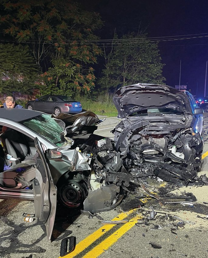THE AFTERMATH: This image provided by Cranston Police shows the aftermath of a fatal head-on collision that occurred the night of July 8 on Atwood Avenue.