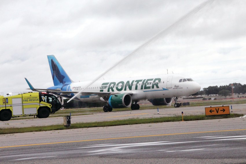 WATERY WELCOME: Frontier's inaugural flight from Atlanta was greeted Monday afternoon with a water cannon salute. (Warwick Beacon photos)