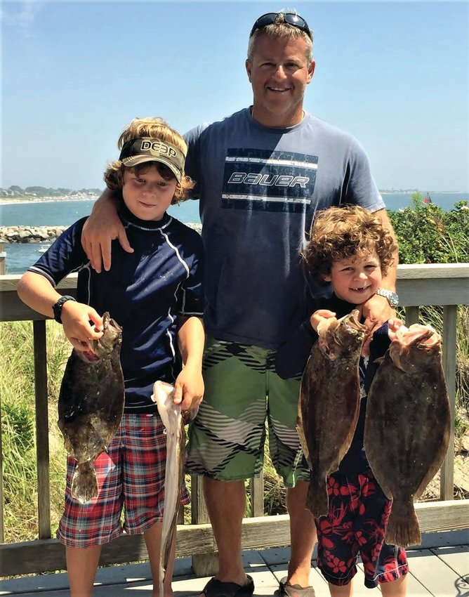 BLUEFIN MAGIC: In 2016 Jude (nine) and Rowan (six) with father Jimmy Monti of Warwick with summer flounder.