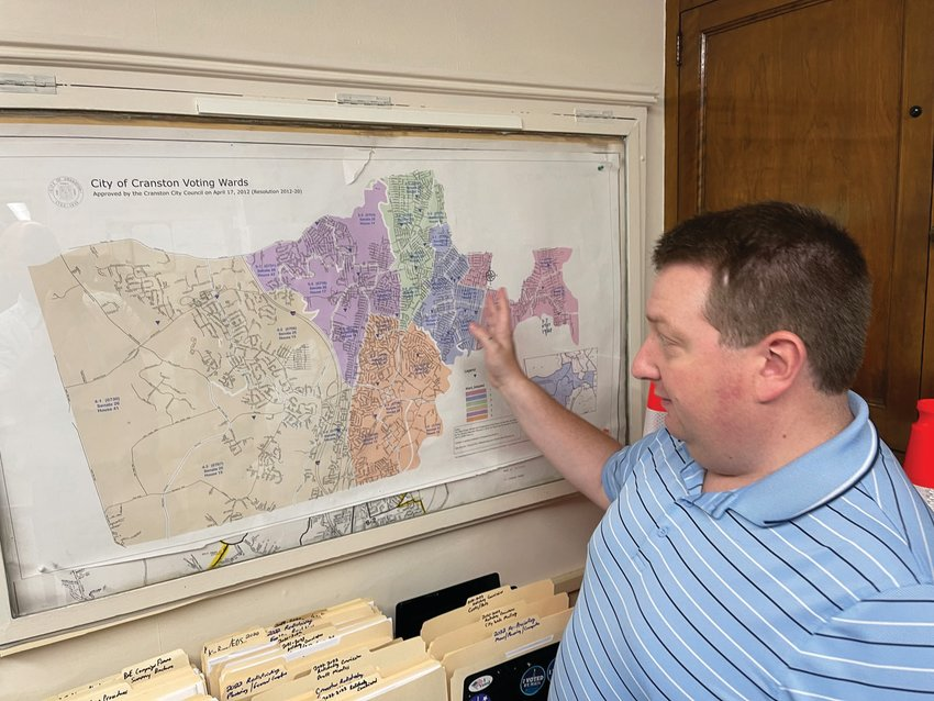 MAPPING IT OUT: Nicholas Lima, the city's registrar and elections director, discusses the ongoing redistricting work in the Canvassing Department's office at City Hall.