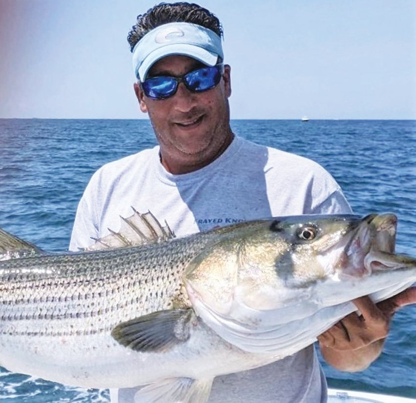 """WINNING BASS: Richard Lipsitz of North Kingstown with the 47.5-inch striped bass that took first place, his team """"Frayed Knot"""" took the team award too in the Block Island Inshore Tournament."""