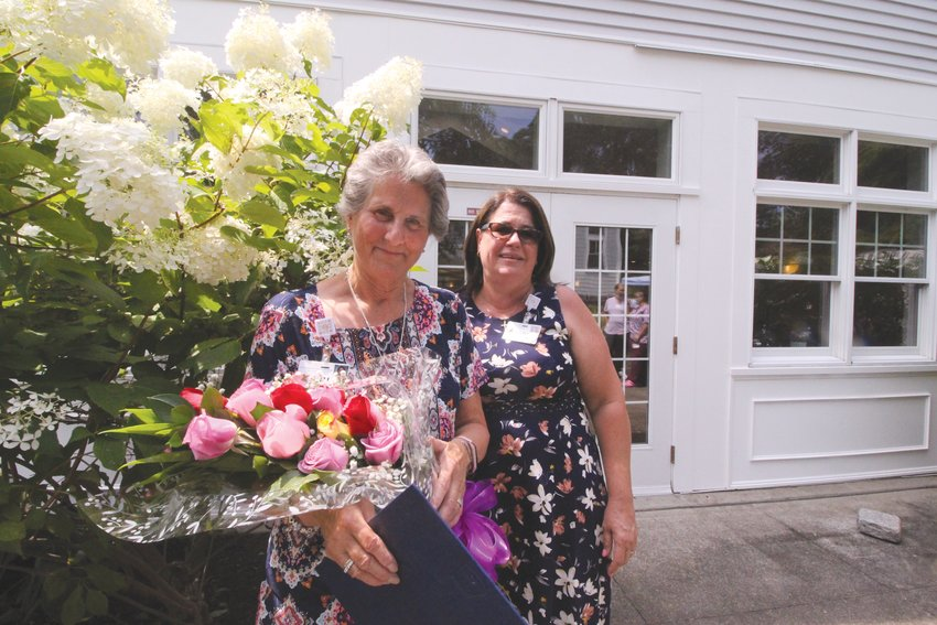 A ROSE FOR EVERY YEAR: Linda Sinnott, program director, presented Kim Morris with a bouquet of roses – one rose for every year – Monday at Cornerstone Adult Day Care Services, where Morris has worked for the past 35 years.