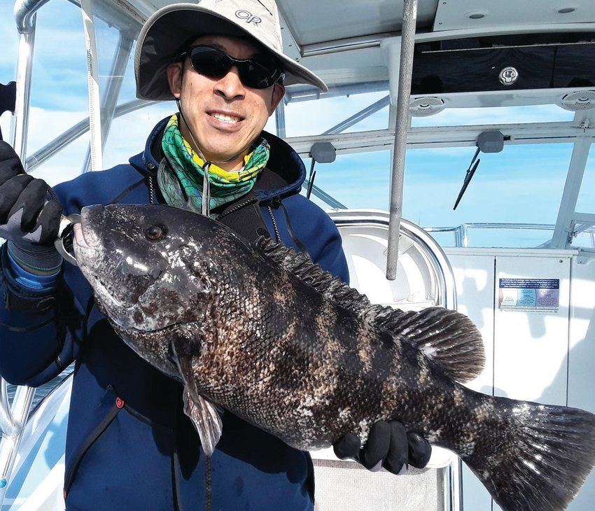 TAUTOG SEASON: Jamie Wong with a tautog caught in the fall off Newport. Tautog season opened with a three fish/person/day limit (16-inch minimum size) this week in Rhode Island and Massachusetts.