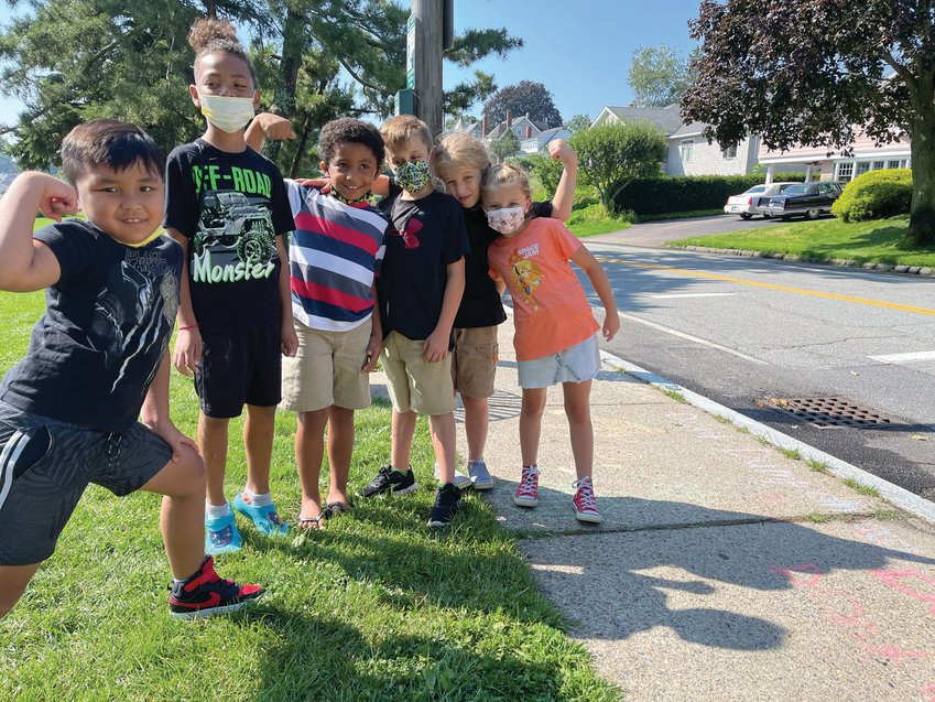 TEAM EFFORT: The youngest students in the STEM Advantage summer program gathered at Stillhouse Cove last week to celebrate the culmination of their six weeks of work, which included weekly gatherings at the cove. Some of the students tagged storm drains with chalk to help education passers-by about the dangers of pollution. Pictured, from left, are Ayden Barron, Kendriech Xayapanya. Matthew Holman, and Temperance, Minos and Emery Cleveland. (Herald photos by Daniel Kittredge) keychain