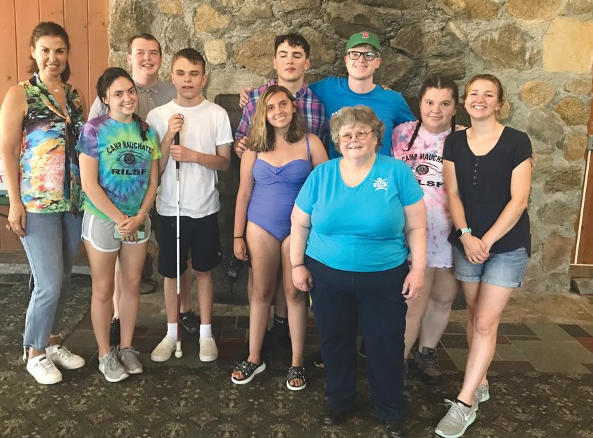 AT CAMP: OSCIL staff members Mirelle Sayaf, Beth Pinkham and Amanda Reed are pictured with students of the Youth Transition Program.