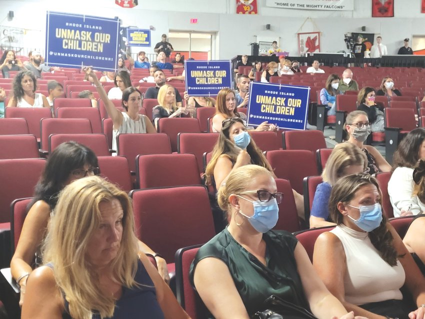 TWO SIDES: Parents packed the Cranston High School West auditorium for a public hearing on a mask mandate for the city's school system.