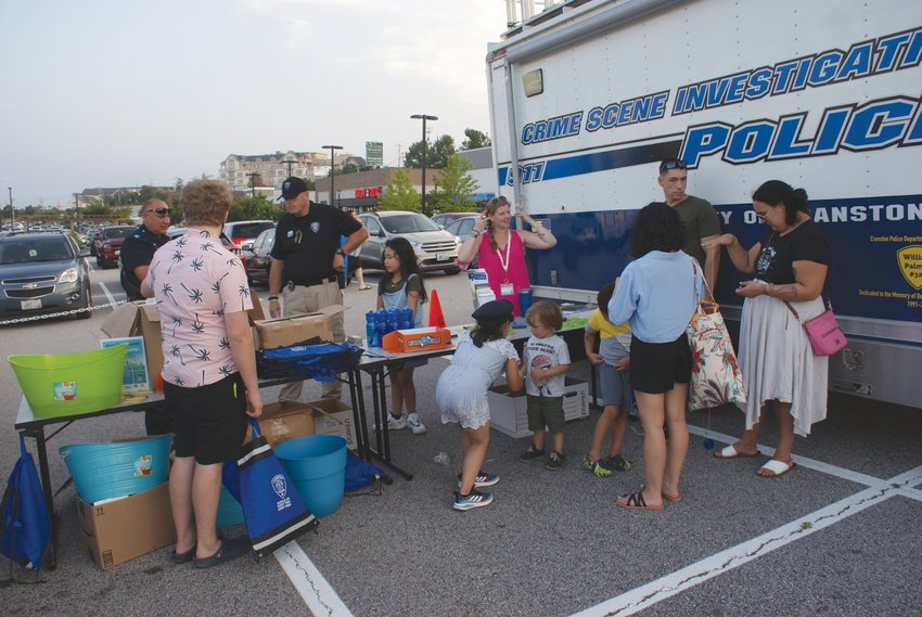 GETTING TO KNOW YOU: Members of the Cranston Police Department met with community members at just one of the informational tables set up during the Garden City Summer Concert last Wednesday.