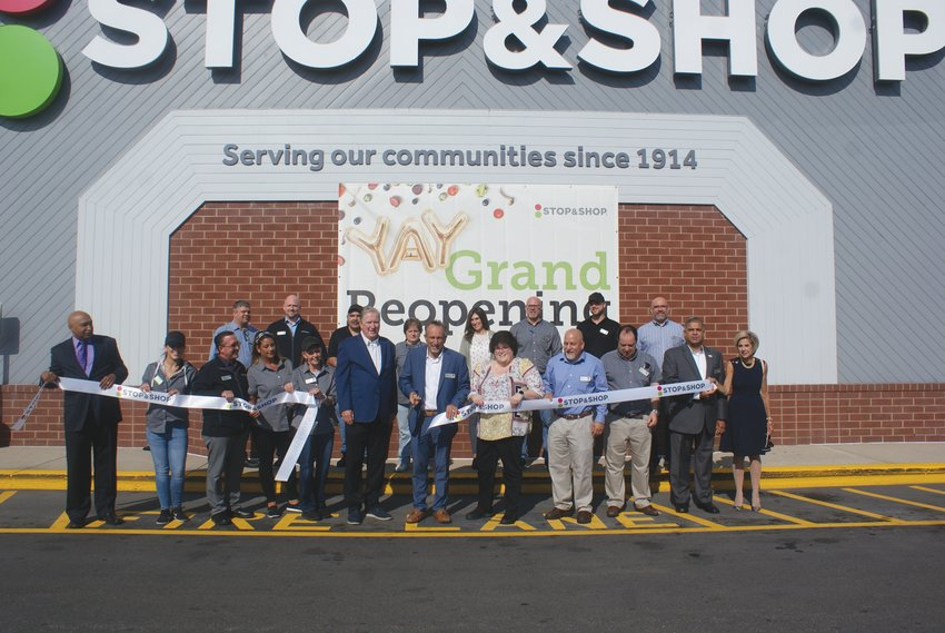CELEBRATION: Last week, Stop & Shop located on Atwood Ave., was joined with Mayor Ken Hopkins as they unveiled their newly renovated store. Pictured at the Ribbon Cutting along with the Mayor is Rick Fraielli, Store Manager and employees.