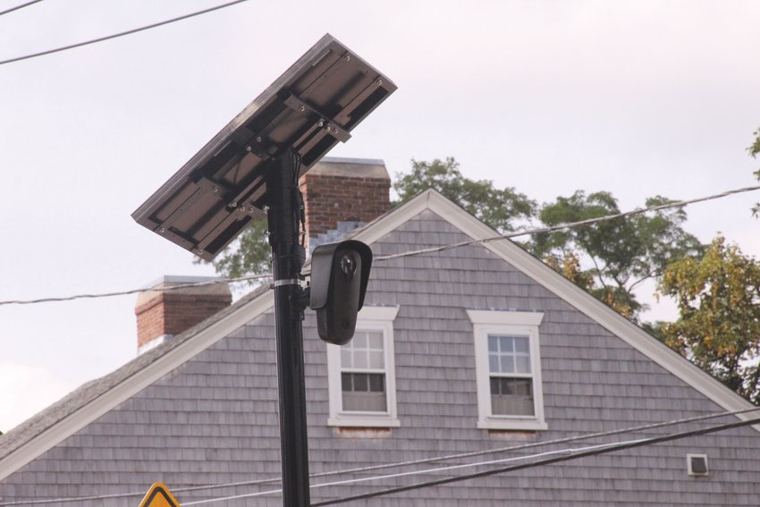 KEEPING AN EYE OUT: The license plate reading cameras from Flock Safety, like this one in Pawtuxet Village, were  the subject of Monday's special City Council meeting. (Herald file photo)