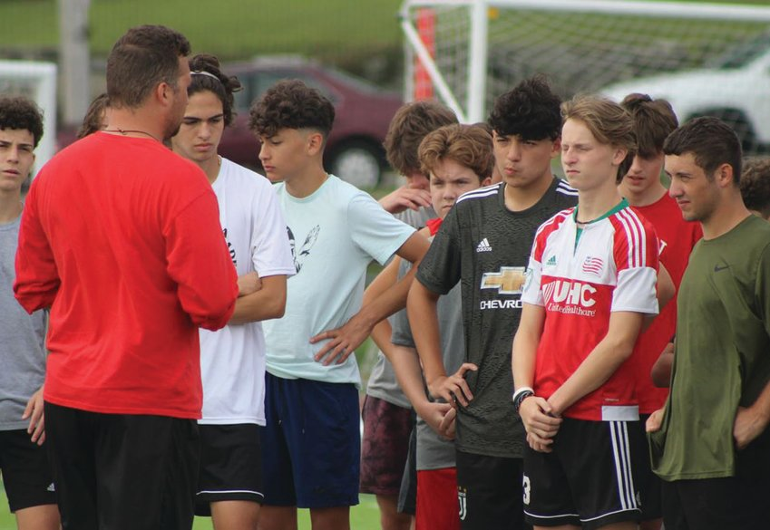GETTING STARTED: The Cranston West boys soccer team gathers prior to a recent practice to talk strategy. The Falcons are coming off a first-place season in which they made the playoffs, and are looking to take the next step toward a title with their experienced core.