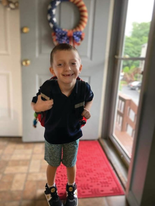 A FUTURE ANIMATOR: First grade bound Quinn Carosi wants to be a Disney Imagineer when he grows up. He started school at the Thornton Elementary School Wednesday.