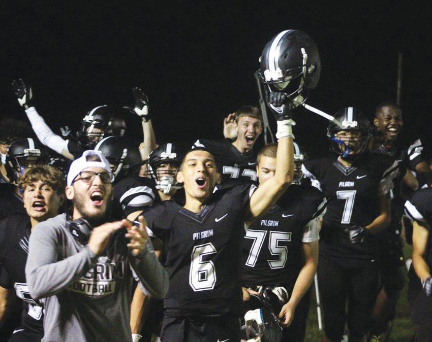 WINNING DRIVE: The Pilgrim football team after scoring the game-winning touchdown.