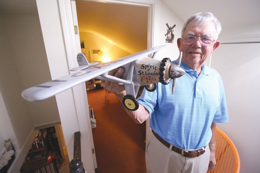 PAYING THE DOCTOR: Bill displays a porcelain model of the Spirit of St. Louis, which is actually a wine bottle, that  one of his patients gave him as a payment. Another patient, an elderly woman, gave him a gun rather than cash.