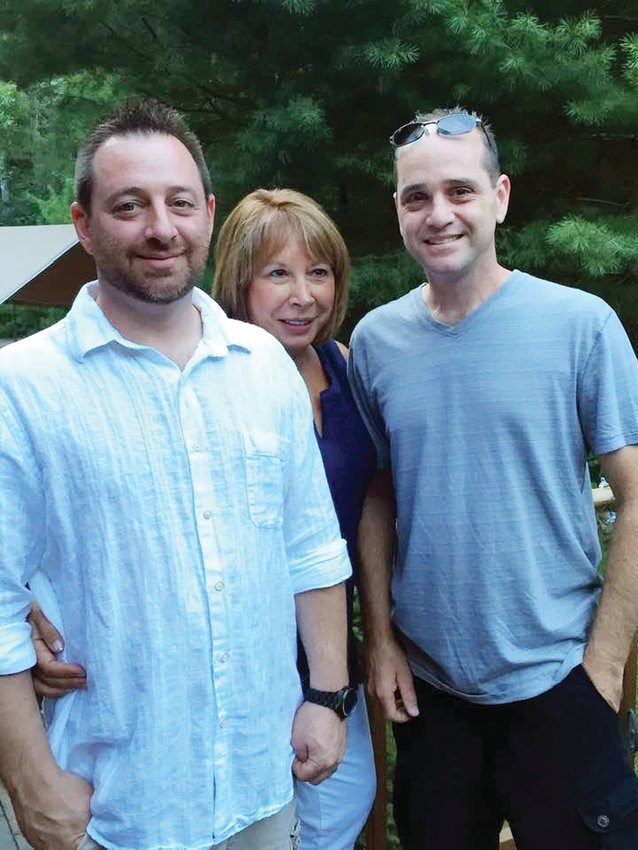 """Tim Gibb, the new co-owner of Precision Collision Service in Cranston, is seen here with his mother Vicki and his late brother Keith who passed away a year ago at this time of Juvenile Diabetes.  The """"Cruisin' for a Cause"""" Car Show is held this Saturday in his honor."""