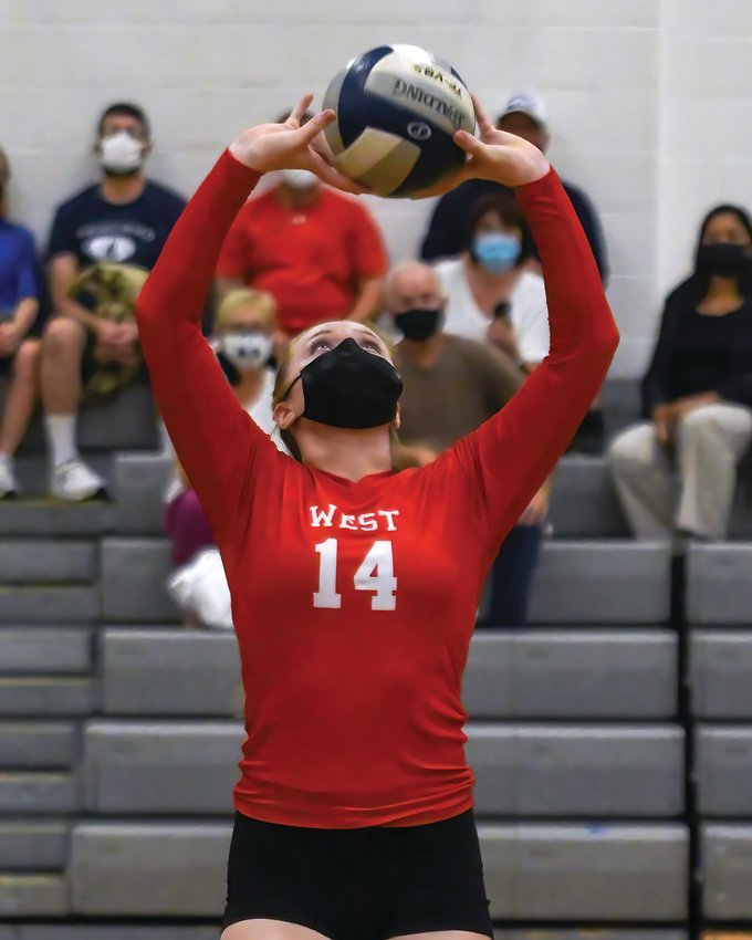 STRONG START: Cranston West's MacKenzie Bessette returns a shot against rival Cranston East during the teams' season opener. The Falcons would go on to sweep the Bolts in three sets and later beat  Mount St. Charles the following  match to improve to  2-0.