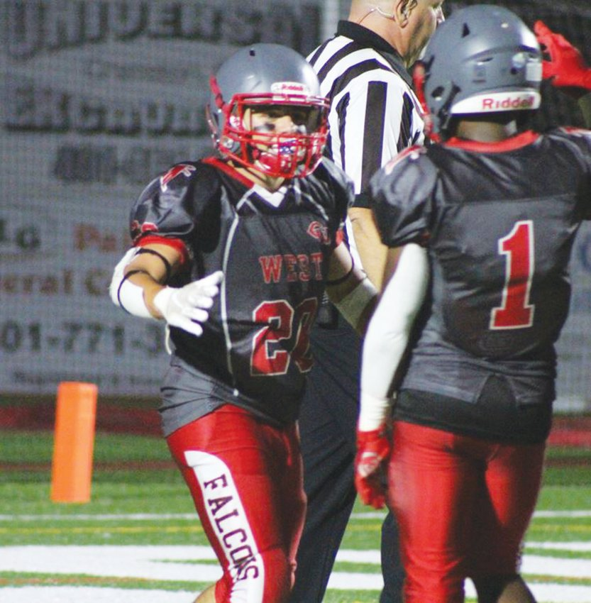 GETTING THE WIN: West's Dimitri Leblanc (20) and Marcus Chung (1) celebrate.